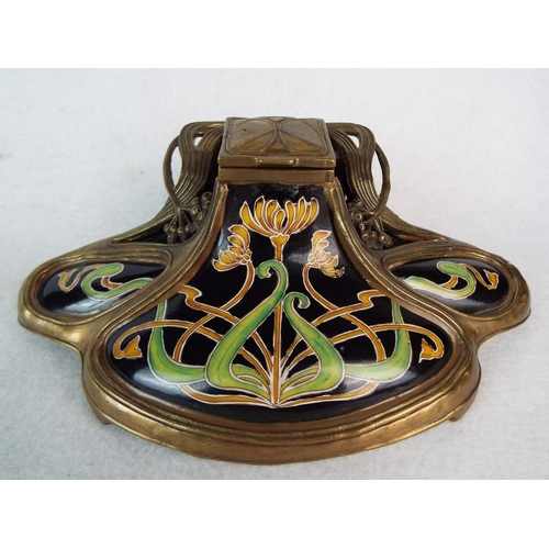 13 - Art Nouveau ceramic inkwell with brass cage surround. 8 inches wide.  JBT anno 1906 to base....