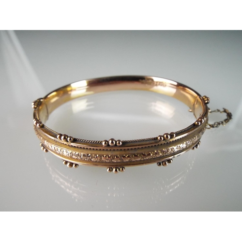 2 - 9ct Fancy gold Bangle with safety chain. 9.3g...
