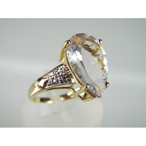 21 - 9ct Pear shaped Mozambique Morganite & 8 African Diamond set ring. 3.2g...