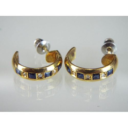 28 - Pair of 18ct earrings set with Diamonds and Sapphires....