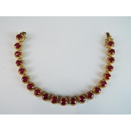 38 - Lovely Silver Bracelet overlaid with 14ct gold set with 21 triple A, African Rubies....