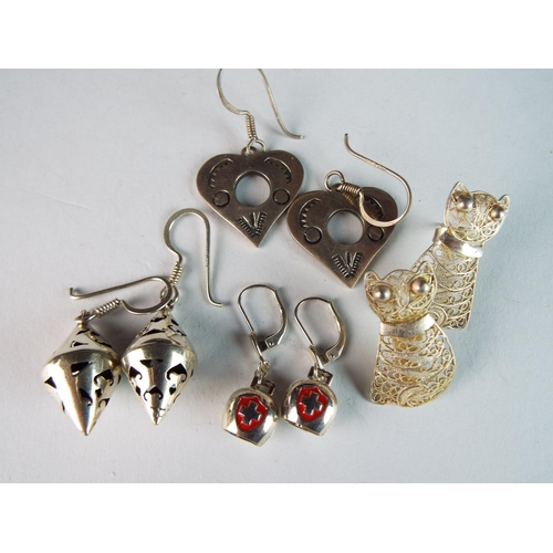 47 - Four pairs of novelty silver earrings....