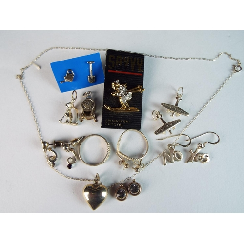 50 - Mixed silver jewellery lot to include rings, earrings, charms, plus Swarovski brooch....