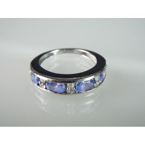 8 - 9ct ring set in Tanzanite with sri lankan white sapphire surround. 'P'  3.3g   Gem weight 2cts....