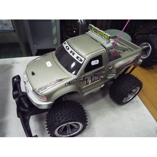 17 - Ford F150 Bigfoot type buggy model electric motor with plastic body. 20 inches long. Working conditi...