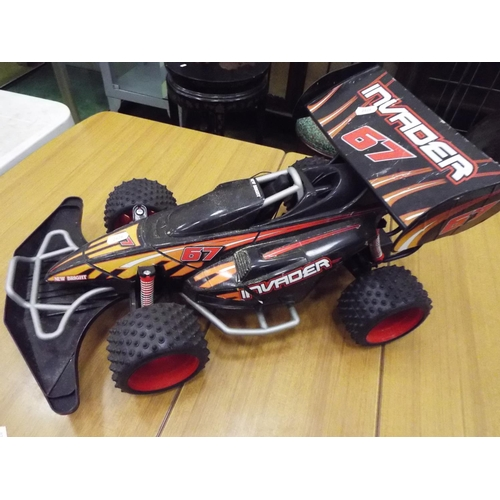 24 - Electric powered racing car, 20 inches long. Working condition unknown....