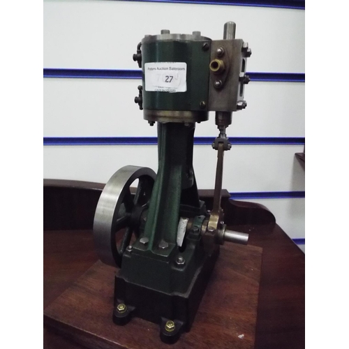 27 - Stuart Number 4 non reversing steam engine on wooden plinth. 11 inches tall standing on wooden plint...