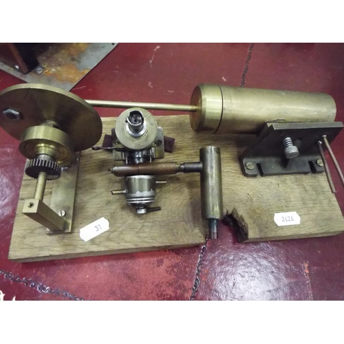 31 - Components from steam engine mounted on wooden base...