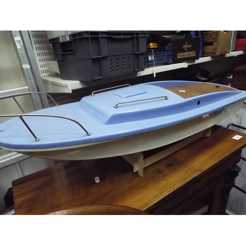 5 - Hull and Superstructure of a powerboat in plastic with electric motor. 32 inches long. Working condi...