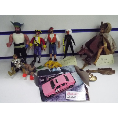 51 - Three platic pirate figures plus 'Storm' (X-men) plus G-Ra (He-Man) Along with a Bab's Cabs Royston ...