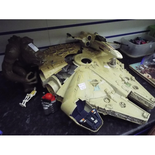 56 - Star Wars Millenium Falcon, a Lancor Monster, plus one other space craft....