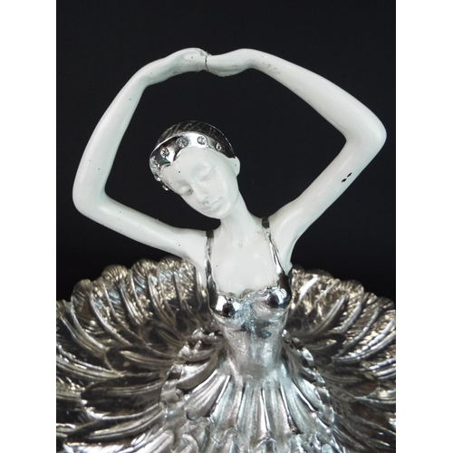 12 - Large and heavy table centre piece as a Ballerina. 12 inches tall, 15 inches in diameter. Light flak...