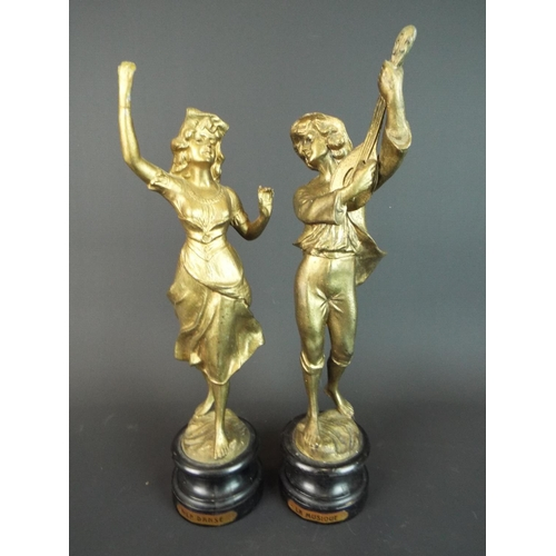 14 - Two gold painted French spelter figurines, La Danse & La Musique, each raised on turned ebony base.1...