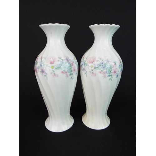 18 - Pair of Wedgewood twist baluster vases, each approx 8 inches tall.