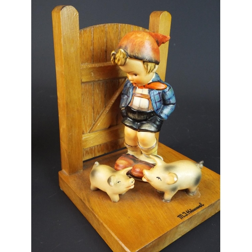 20 - Matched pair of Hummell bookends each approx 6 inches tall. (slight flake to pigs ear otherwise all ...