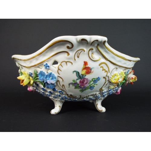 32 - 19th Cent Dresden footed bowl encrusted with flowers and raised on curved feet. 8 inches long.