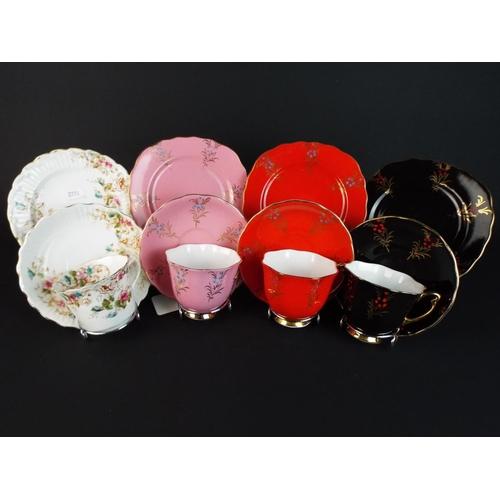 39 - Four pretty bone china cabinet trio's