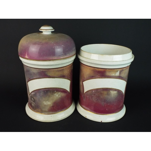 40 - Two chemists jars (one minus lid) 8 inches tall.