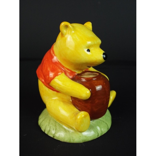 48 - Royal Doulton Winne the Pooh and the honeypot figure. 3 inches tall.