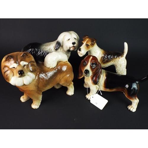 50 - Four Coopercraft ceramic dogs