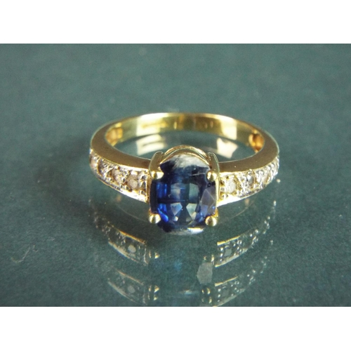 53 - 9ct Yellow Gold ring set with a large Sapphire with moisanites to the Shoulders.  Finger size 'N-5' ...