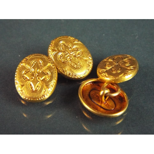 54 - Pair of 15ct Yellow gold cufflinks with decorative scrolled decoration.  6.9g