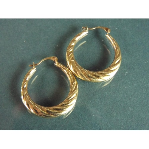 55 - Pair of 9ct Yellow gold Creole hoop earrings.  1.0g
