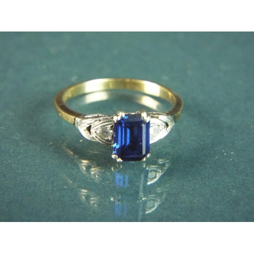 57 - 9ct Sapphire set ring with clear stones to shoulders. Finger size 'M-5'  2.6g