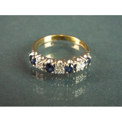 58 - 9ct ring set with Diamonds and Sapphires.    Finger size 'N-5'   2.4g