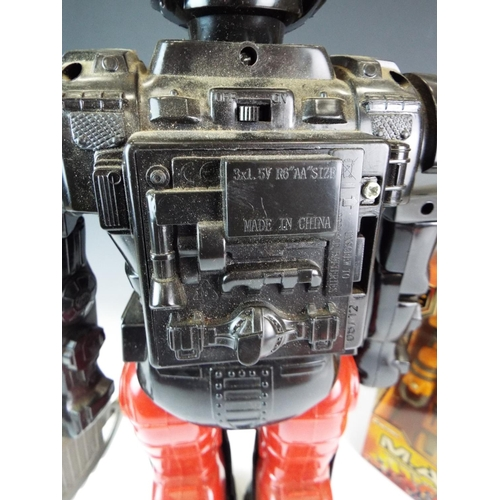 11 - Large Battery operated walking robot with flashing lights in working order. Plus two other boxed and...