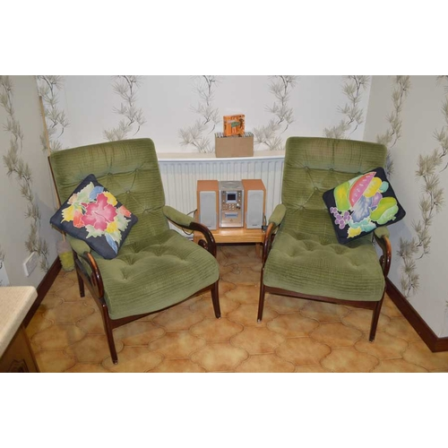 60 - A Comfortable Pair of Upholstered Armchairs and their Cushions...
