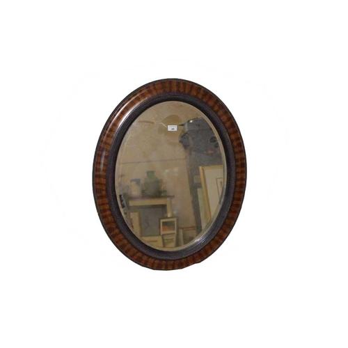 43 - An Oval Framed Mahogany Mirror...