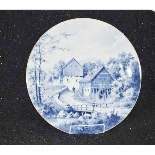 32 - A Large Blue and White Circular Plate