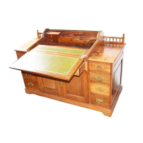 55 - A Walnut Desk with Tambour Fitted Writing Slope