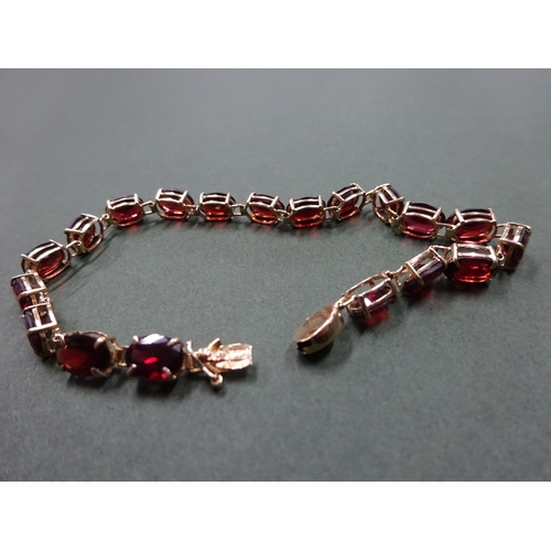 3 - 14ct gold bracelet with 19 dark garnet oval stones, total weight 6.4g...