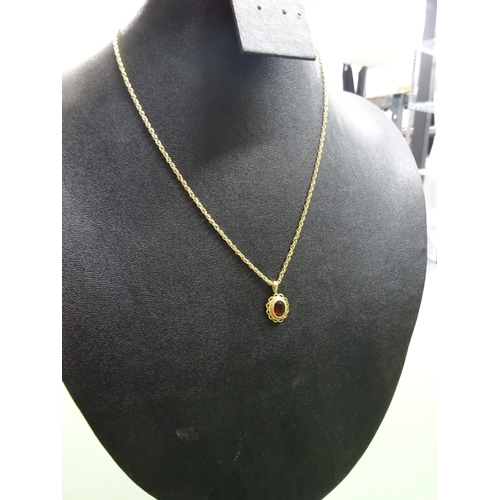 5 - 9ct gold fine necklace with 9ct gold pendant having a oval dark red stone, total weight 4.5g...