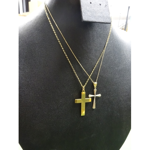 6 - 9ct gold crucifix on circle ink chain, white metal detail, and two further examples, weight 10g (4)...