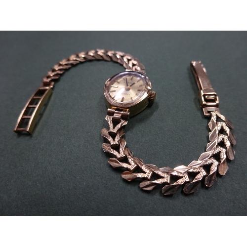 7 - 9ct gold encased Everite Quartz bracelet watch,  'v' link bracelet, total weight 9.6g...