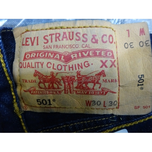 404 - Four pairs of new Wrangler Levi jeans (30W 30L)...