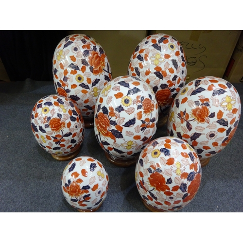 45 - (F) Seven decorative ceramic eggs...