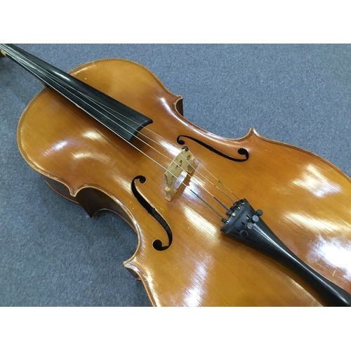 29 - 20th Century cello with two-piece flamed maple back and sides with deep carved spruce top...