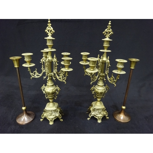 24 - Selection of brass candle holders...