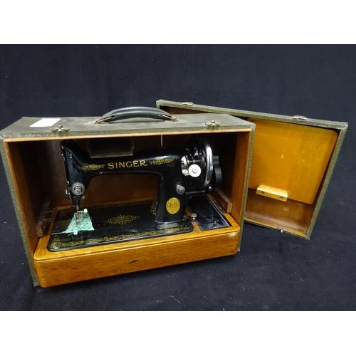 50 - Singer sewing machine in case...