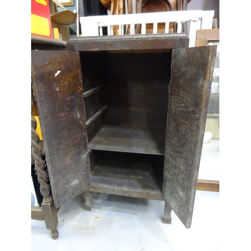 11 - Small dark wood unit with cupboard doors...