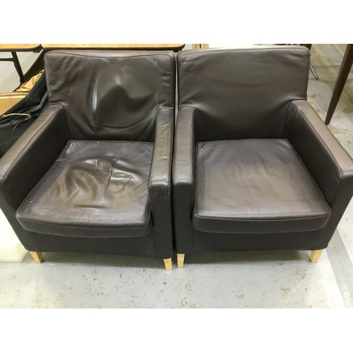 137 - Two modern leather style chairs...
