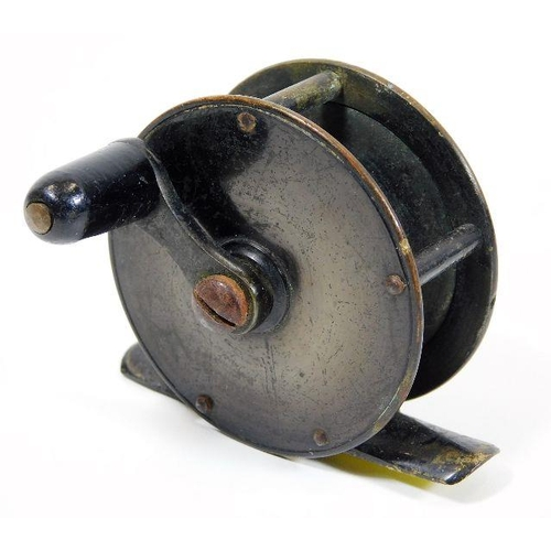 46 - A bronze fishing reel...