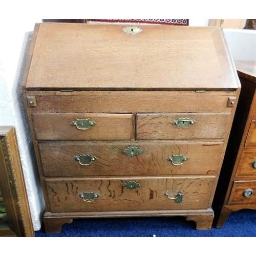 1 - An 18thC. oak bureau with brass fittings 32 in wide...