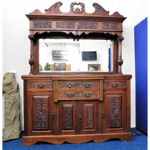 19 - A Victorian mahogany dresser with ornately framed mirror with cupboards over a base of three cupboar...