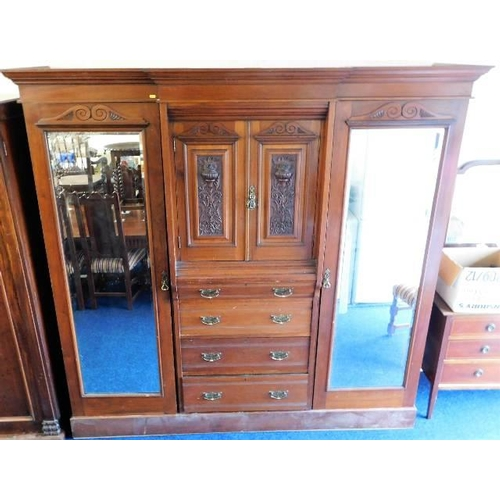 21 - A late Victorian mahogany gentleman's compactum with carved decor 82.5in high x 81.5in wide...