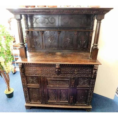 23 - A 17thC. carved oak dresser with green man decor...